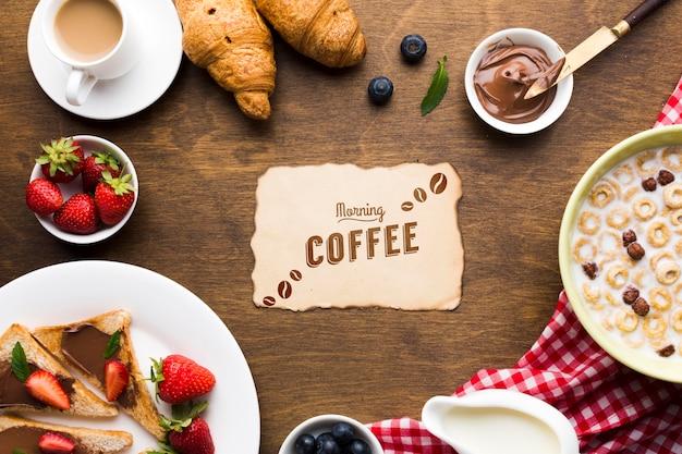 Vue De Dessus De La Nourriture Du Petit Déjeuner Avec Des Céréales Et Des Fruits Et Des Croissants Psd gratuit