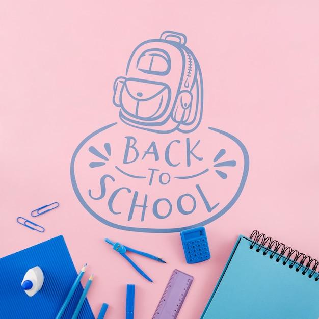 Vue de dessus retour à l'école avec fond rose Psd gratuit