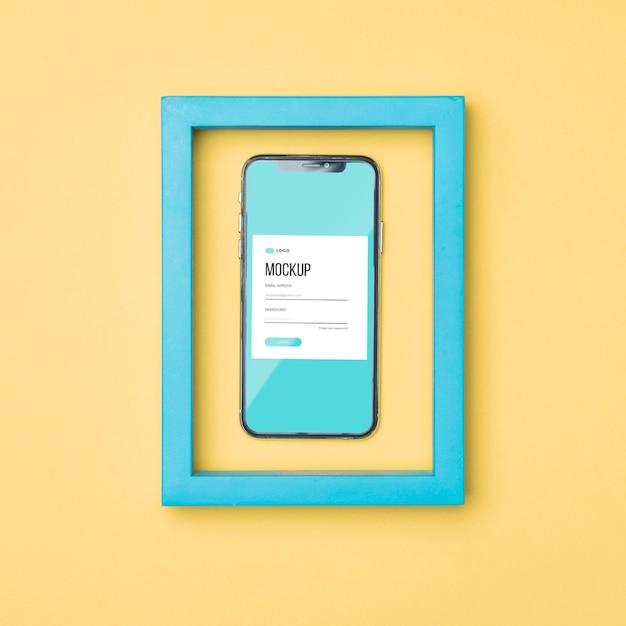 Vue De Dessus Smartphone Dans Une Maquette De Cadre Bleu Psd gratuit