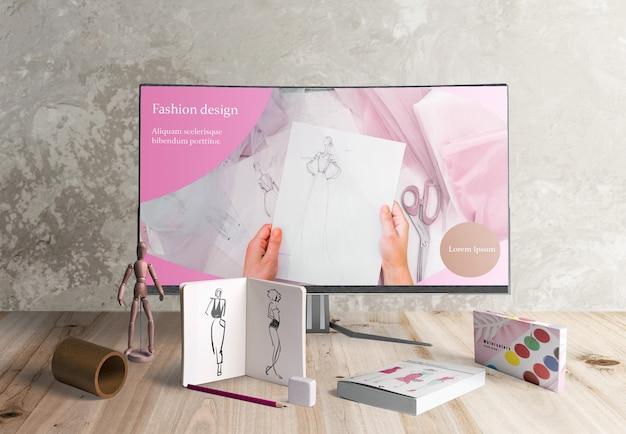 Vue de face du bureau de designer avec acuarelas Psd gratuit