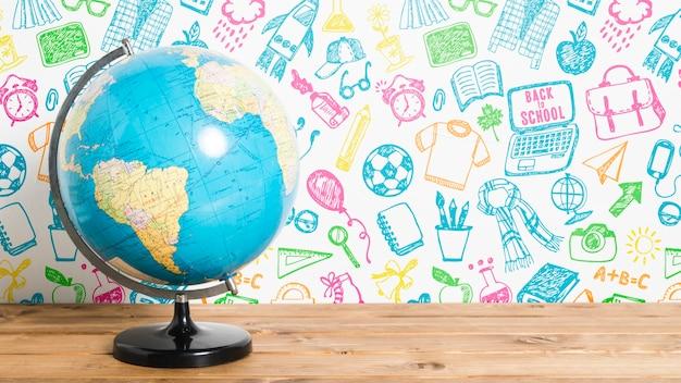 Vue de face à l'école avec globe terrestre Psd gratuit
