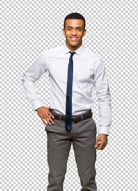 Afro americano jovem empresário posando com os braços no quadril e sorrindo Psd Premium