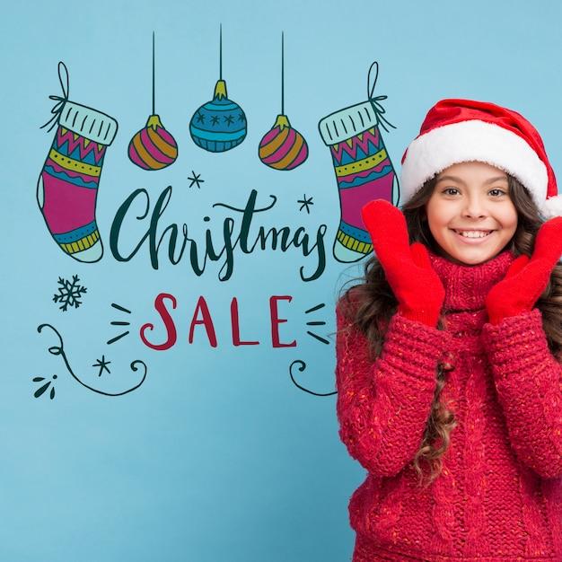 Anúncio de vendas de natal com maquete de menina Psd grátis