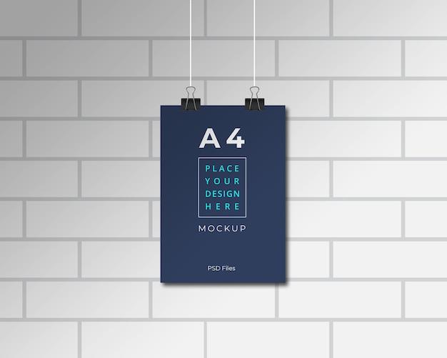 Apresentação de maquete de papel sobre parede de tijolos Psd Premium