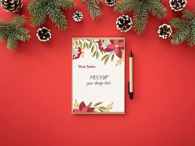 Arranjo de véspera de natal com cartão Psd grátis