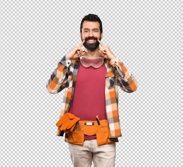 Artesão homem sorrindo com uma expressão feliz e agradável Psd Premium