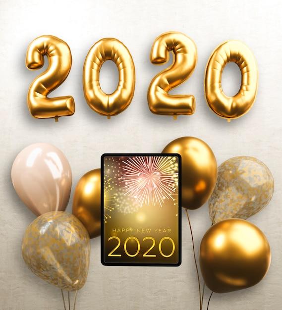 Balões e tablet para o ano novo Psd grátis