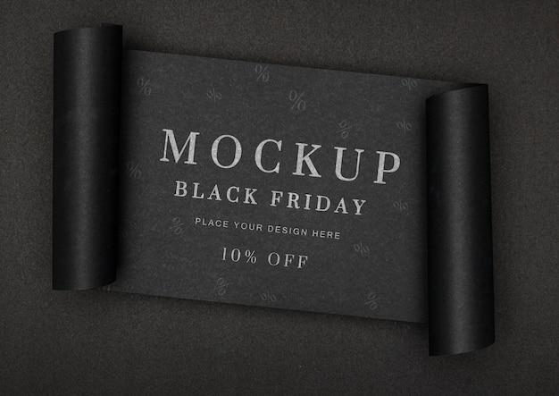 Banner enrolado com fundo preto modelo de vendas na sexta-feira Psd grátis