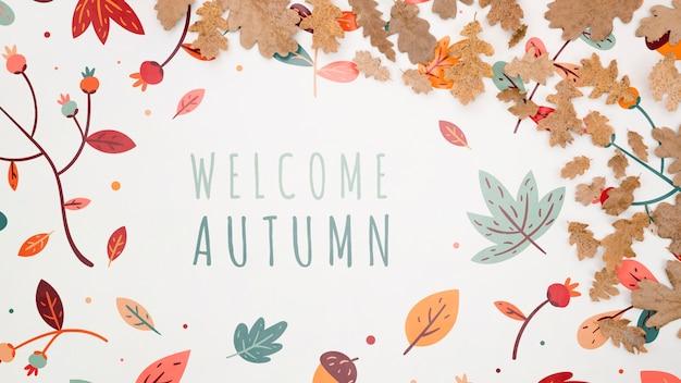 Bem-vindo a rotulação de outono com folhas no fundo liso Psd grátis