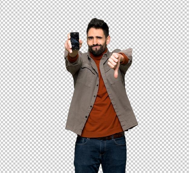 Bonito, homem, com, barba, com, perturbado, segurando, quebrada, smartphone Psd Premium