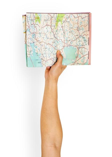 Braço levantado com mapa na mão Psd grátis