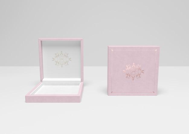Caixa de presente rosa aberta e fechada com capa Psd grátis