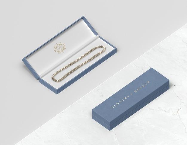 Caixas de presente de jóias azuis com pulseira Psd grátis