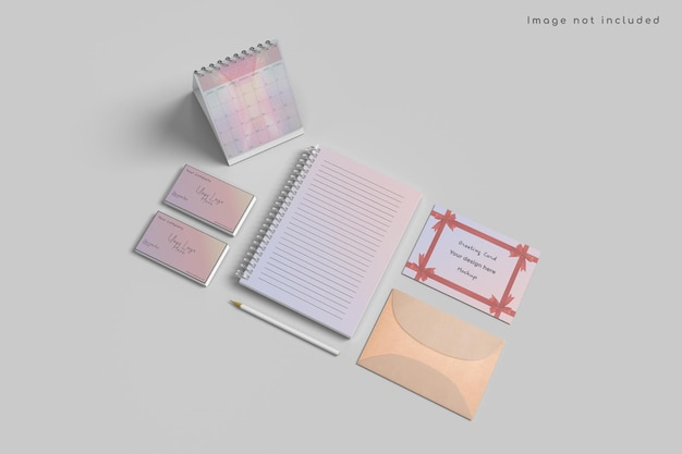 Cartão comemorativo e modelo de calendário em vista de alto ângulo Psd Premium