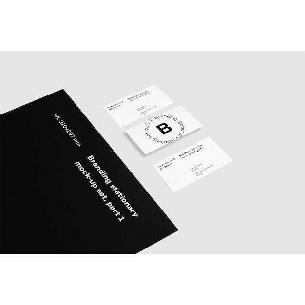 Cartões de visita ao lado de pasta preta mock up Psd grátis