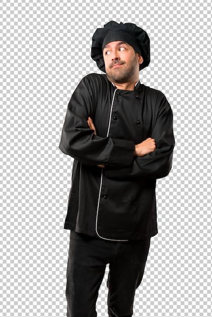 Chef man em uniforme preto fazendo sem importância e duvida gesto enquanto levanta os ombros Psd Premium