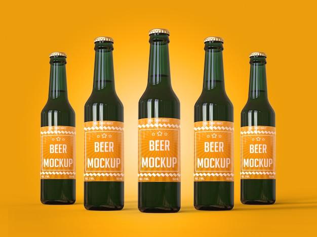 Cinco garrafas de cerveja com uma maquete de rótulo Psd Premium