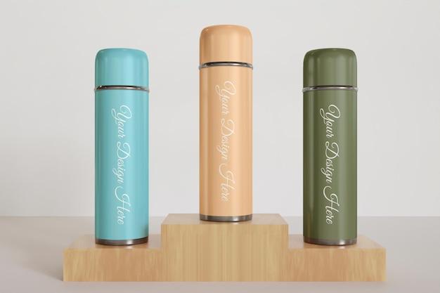 Close-up na maquete do copo ou do frasco a vácuo com várias cores Psd Premium