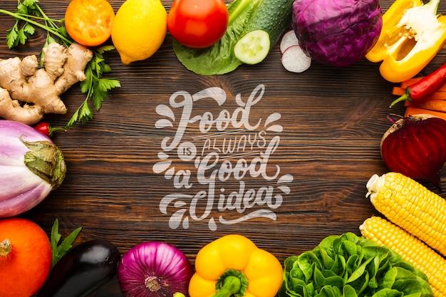 Comida é uma boa idéia de maquete com moldura feita de deliciosos legumes frescos Psd grátis