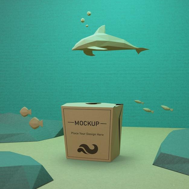 Conceito de dia do oceano com saco de papel e golfinho Psd grátis