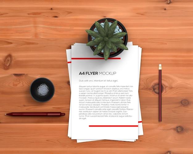 Conceito de papelaria com maquete de panfleto a4 Psd grátis