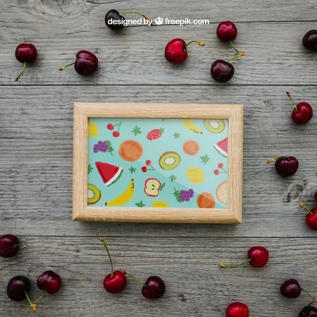 Conceito de verão com moldura e cerejas Psd grátis