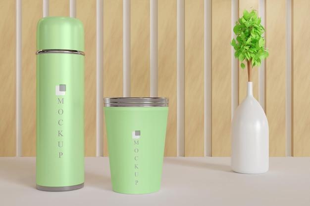 Copo e maquete de copo de bebida com vaso de planta Psd Premium