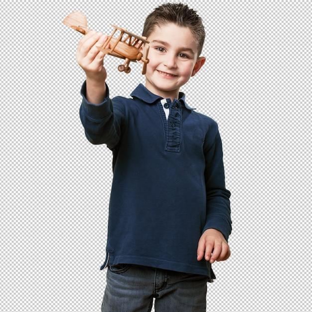 Criança brincando com um biplano Psd Premium