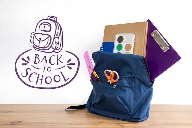 De volta à escola, mochila com material de estudante Psd grátis