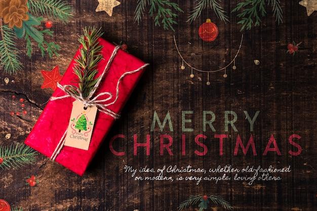 Desejo do feliz natal com presente ao lado Psd grátis