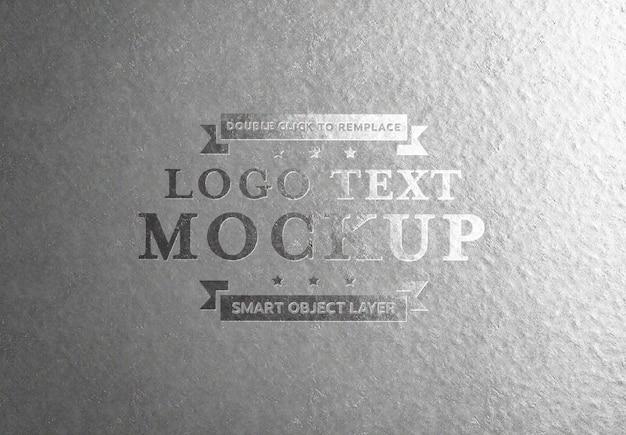 Efeito de texto prateado em relevo na chapa de alumínio Psd Premium