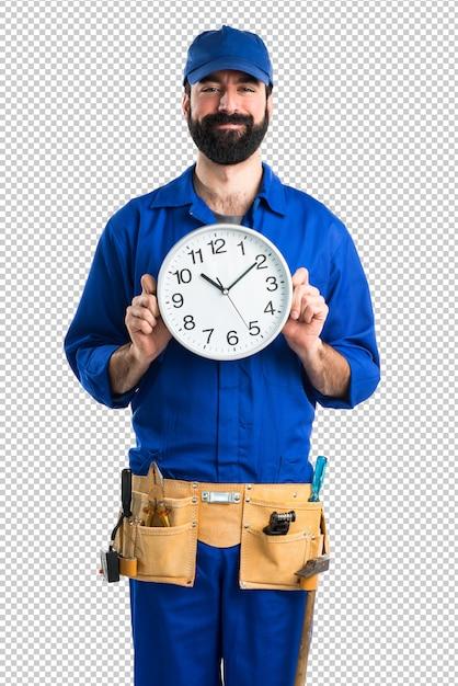 Encanador segurando o relógio Psd Premium