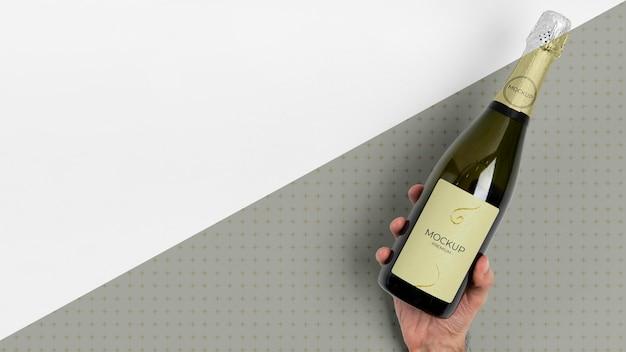 Espaço da cópia do mock-up da garrafa de champanhe Psd grátis