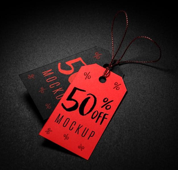 Etiquetas de preço vermelhas e pretas com maquete de vendas da sexta feira preta Psd grátis