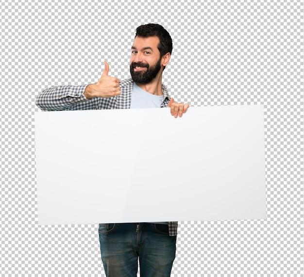 Feliz homem bonito com barba segurando um cartaz vazio Psd Premium