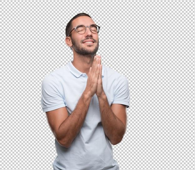 Feliz, homem jovem, orando Psd Premium