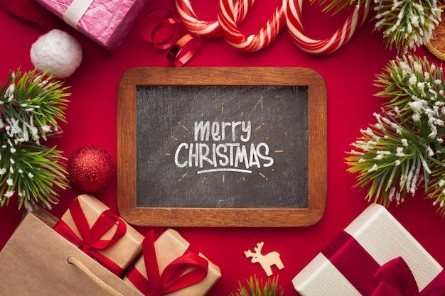 Feliz natal na lousa e fundo vermelho de natal Psd grátis