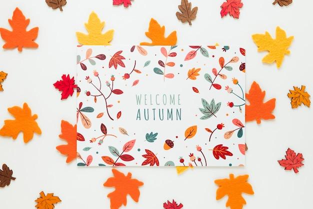 Folhas secas canadenses com citação de outono bem-vindo Psd grátis
