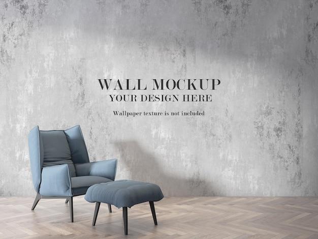 Fundo de maquete de parede da sala atrás de uma poltrona canapés Psd Premium