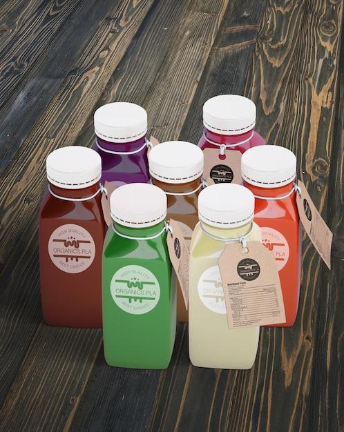 Garrafas de plástico com diferentes sucos de frutas ou vegetais com etiquetas Psd grátis