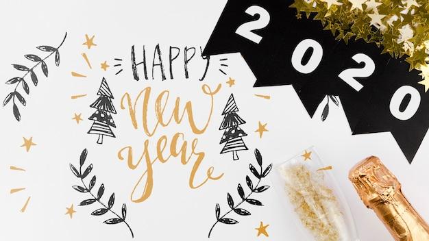 Guirlanda de vista superior 2020 com rabiscos bonitos para citação de ano novo Psd grátis