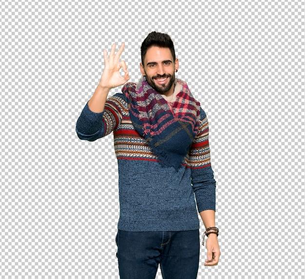 Hippie homem mostrando um sinal de ok com os dedos Psd Premium