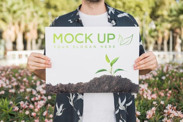 Homem, apresentando, cartaz, mockup, frente, parque Psd grátis