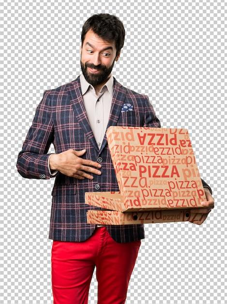 Homem bem vestido, segurando pizzas Psd Premium