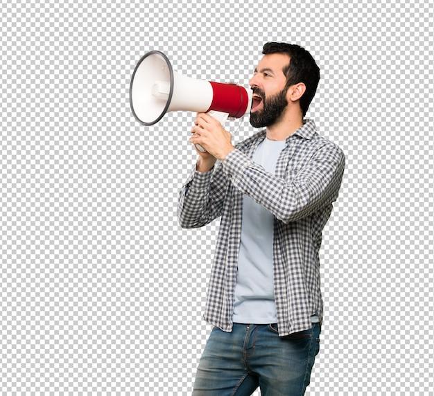 Homem bonito com barba gritando através de um megafone Psd Premium