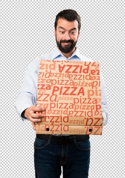 Homem bonito com barba segurando pizzas Psd Premium