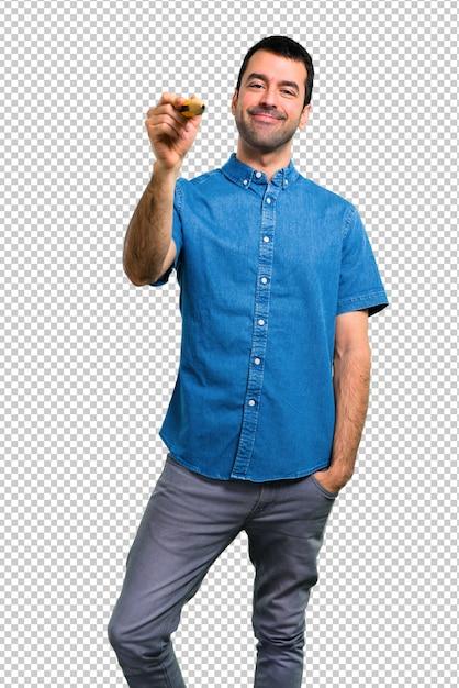 Homem bonito com camisa azul, segurando um grande lápis Psd Premium