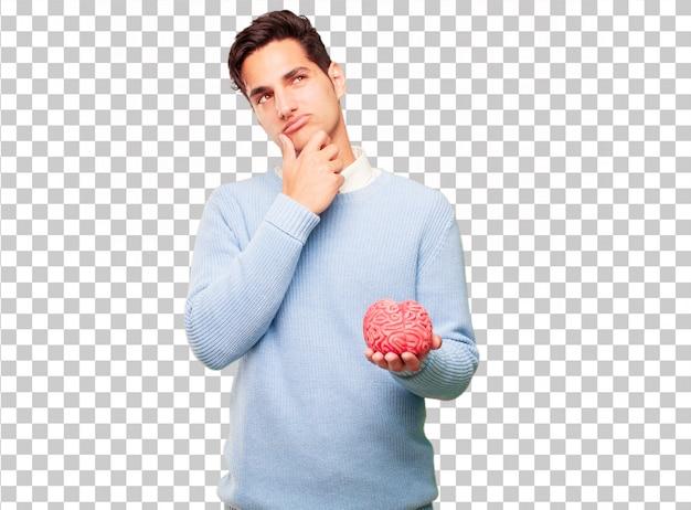 Homem bronzeado bonito jovem com um modelo de cérebro Psd Premium