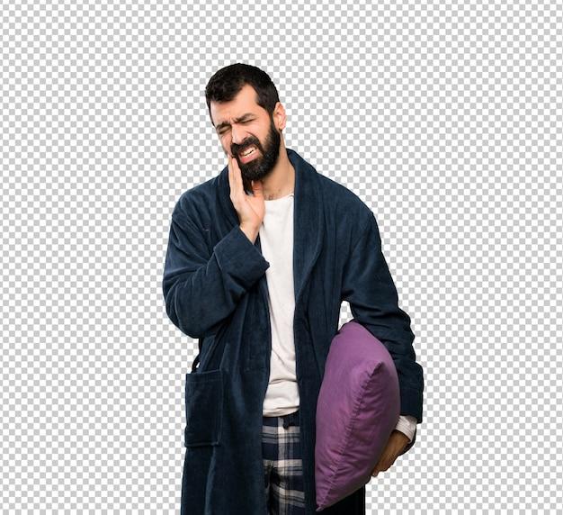 Homem com barba de pijama com dor de dente Psd Premium