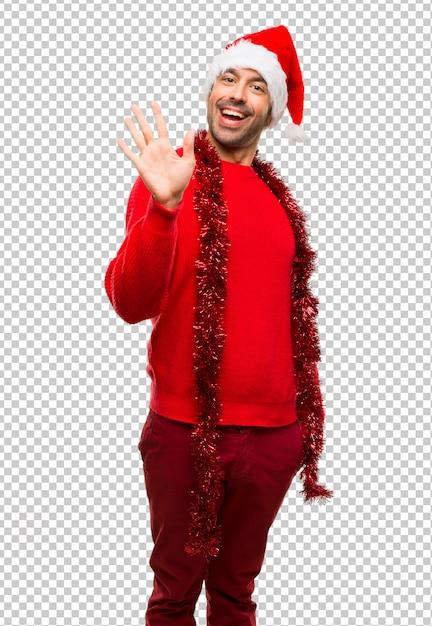 Homem, com, vermelho, roupas, celebrando, a, natal, feriados, saudando, com, mão, com, feliz, expressão Psd Premium